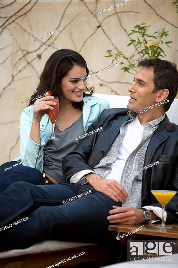 Stock Photo: Couple having drinks in lawn chair.
