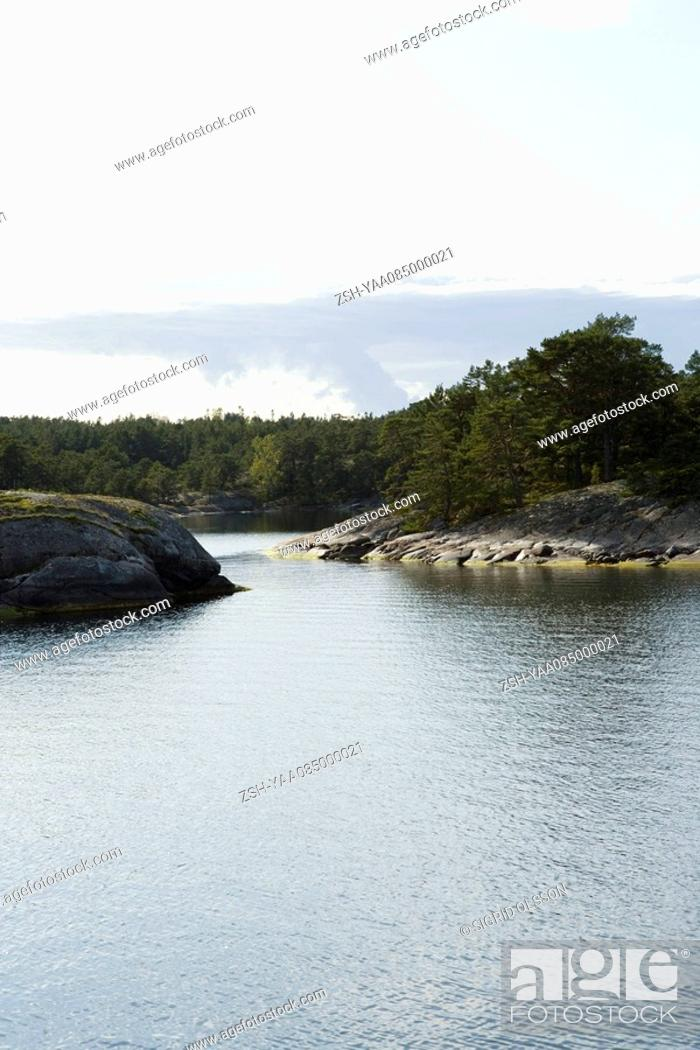 Stock Photo: Lake with cove in background.