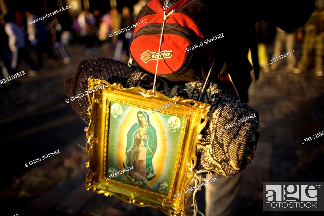 Stock Photo: A pilgrim carries on his back an image of the Our Lady of Guadalupe outside of the Our Lady of Guadalupe Basilica in Mexico City, December 11.