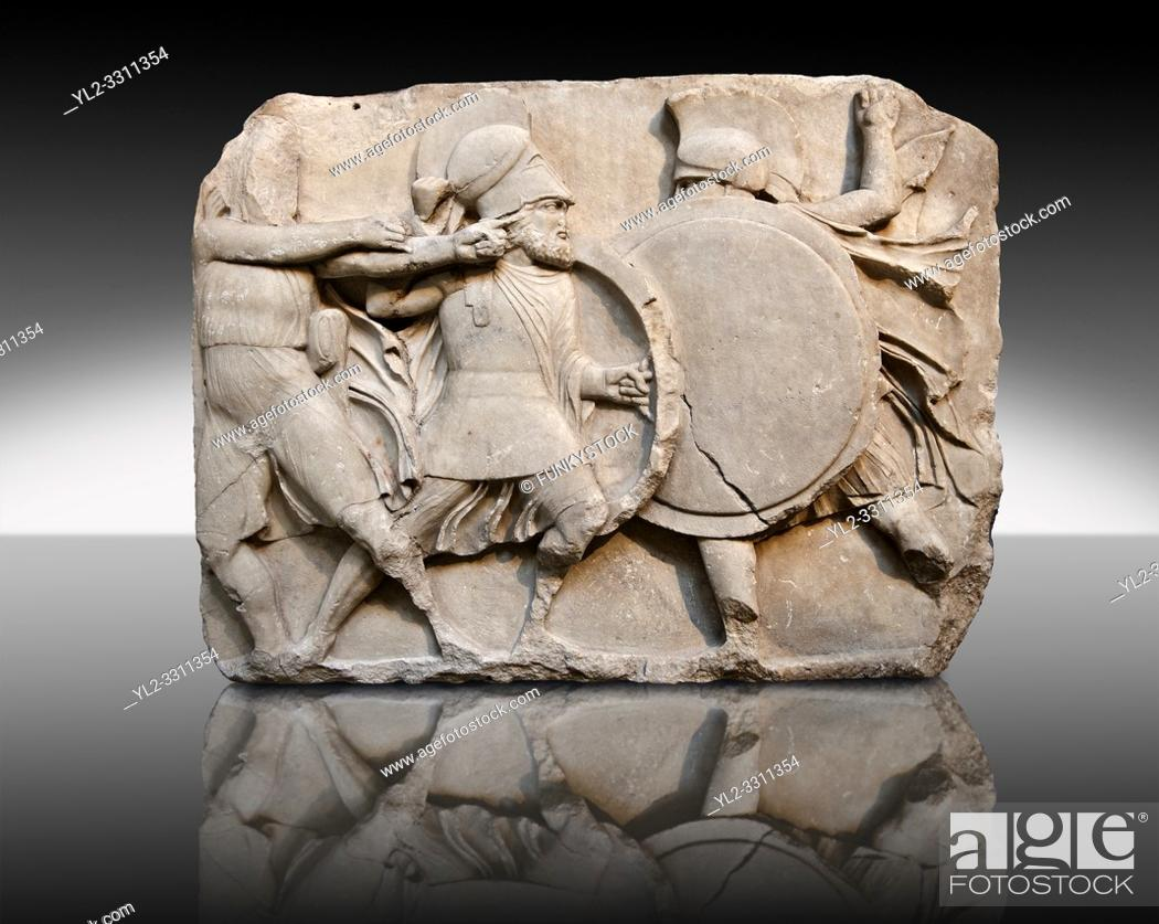 Stock Photo: Two warriors clasing shields on a freeze from the Large Podium of the sculptured 4th cent. B. C Lycian Nereid ( Mythical Greek Sea Nymphs) Monument tomb of.