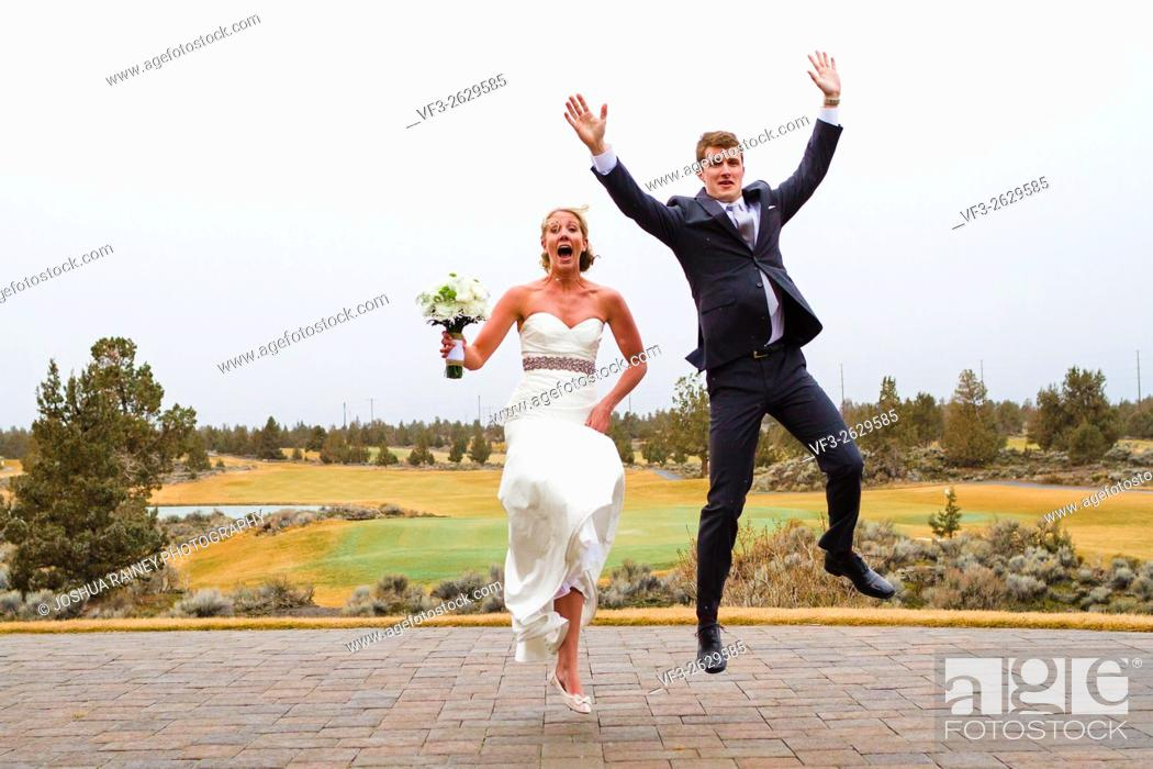 Stock Photo: Central Oregon wedding day portrait of the bride and groom outdoors in the Winter.
