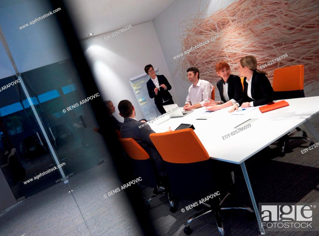 Stock Photo: business people group with young adults and senior on meeting at modern bright office interior.
