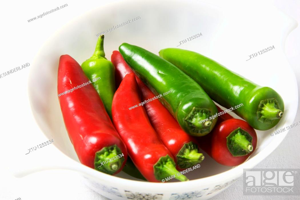 Stock Photo: Red and Green Chili Peppers in a White Dish.