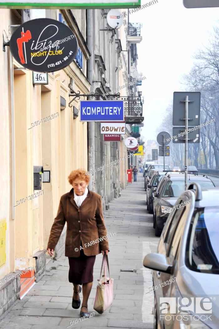 Stock Photo: Pedestrian on street (Komputery means computer), Krakow, Poland.