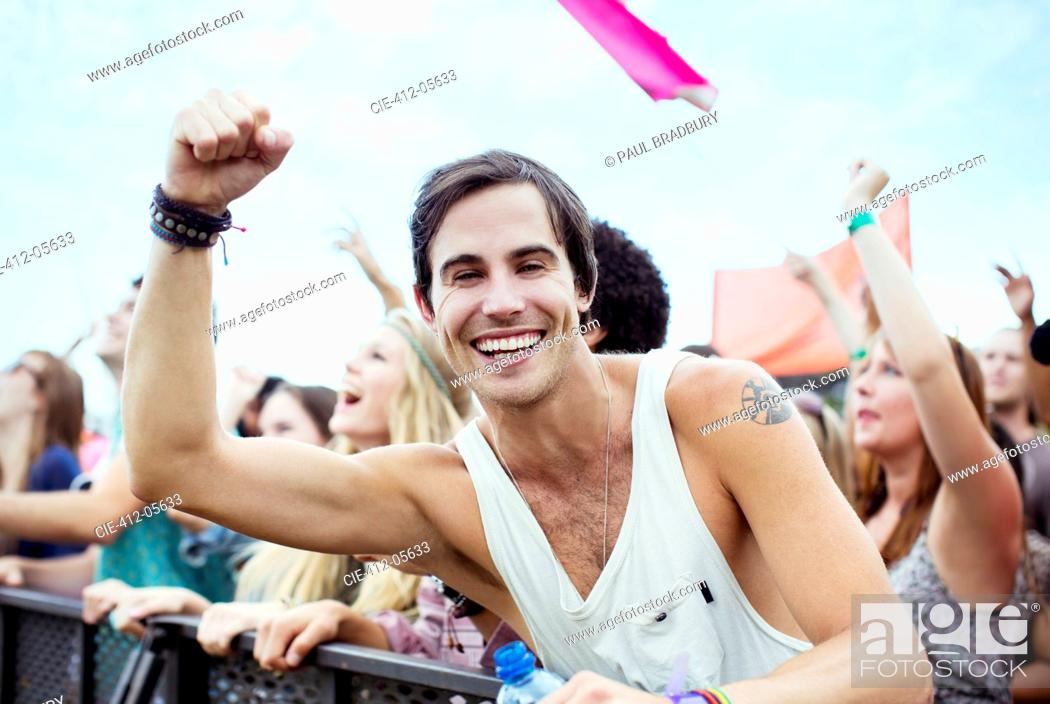 Stock Photo: Enthusiastic man cheering at music festival.