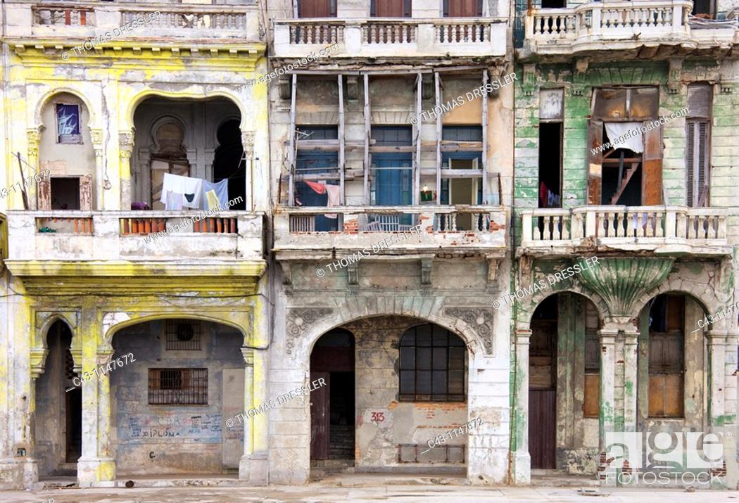 Stock Photo: Cuba - Many buildings and their façades at the Malecón, the famous oceanfront promenade of Cuba's capital Havana, are in quite a bad state.