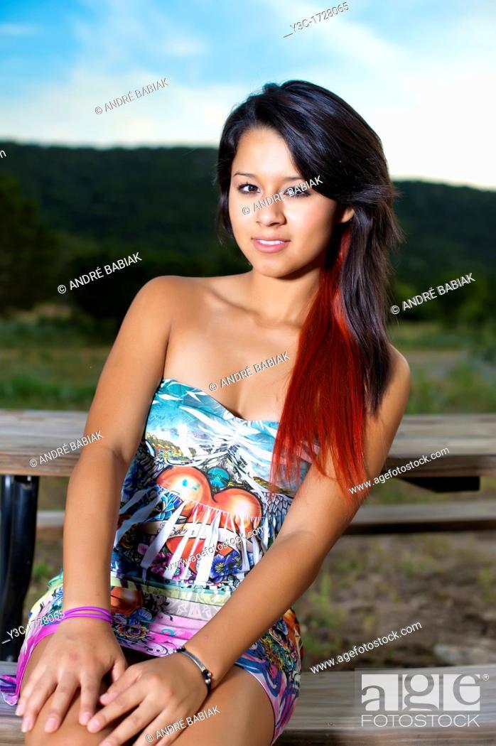 Stock Photo: Beautiful young hispanic woman posing outdoors in summer dress.
