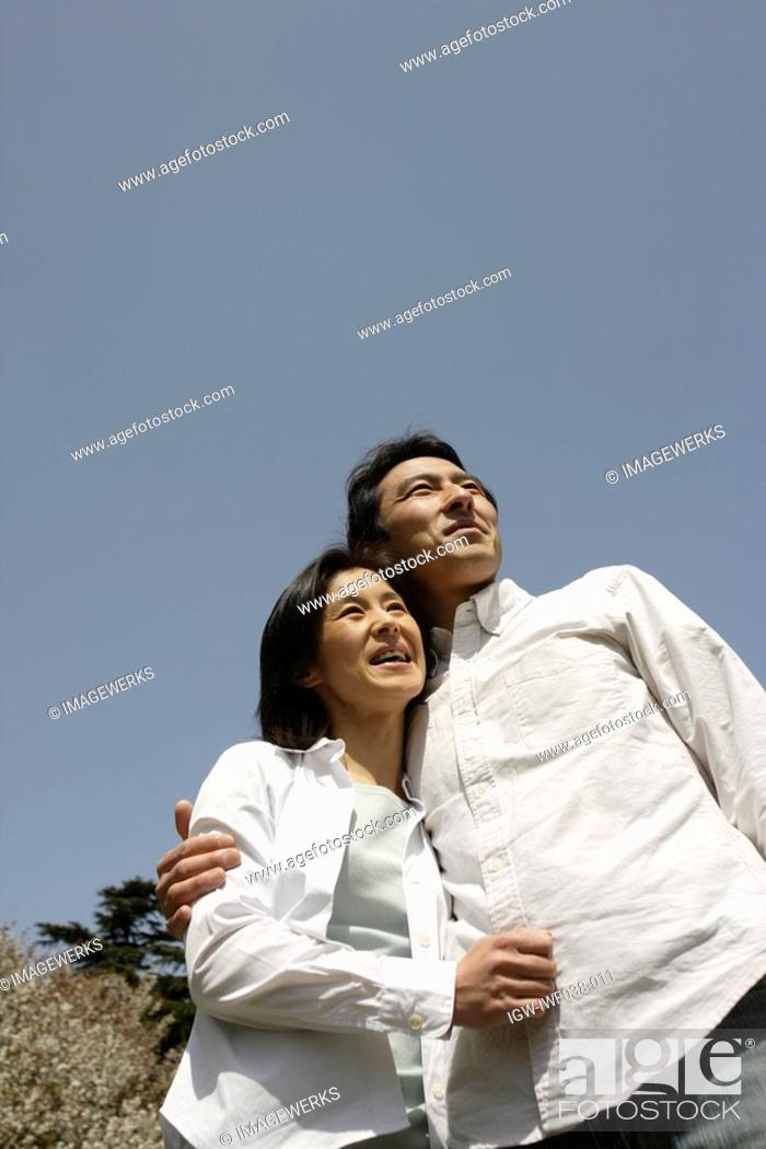 Stock Photo: A young couple smiling.