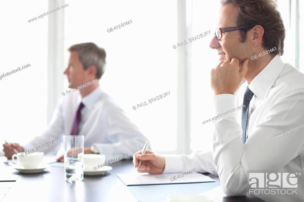 Stock Photo: Businessmen sitting in meeting.