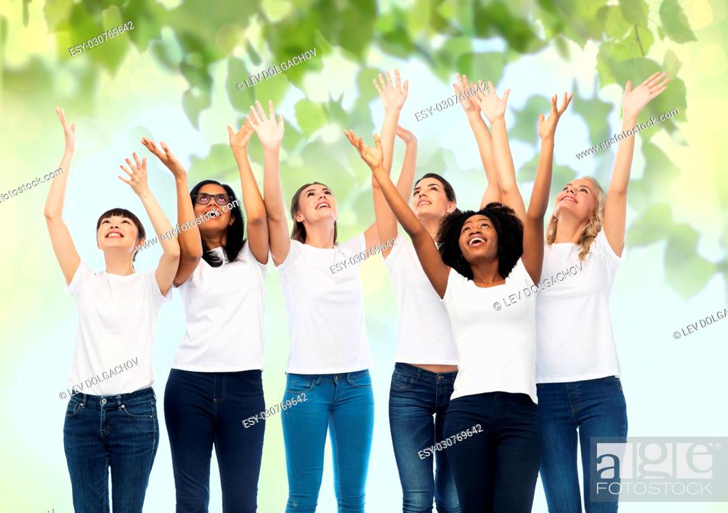 Stock Photo: diversity, ecology and people concept - international group of happy smiling volunteer women in white blank t-shirts having fun over green natural background.