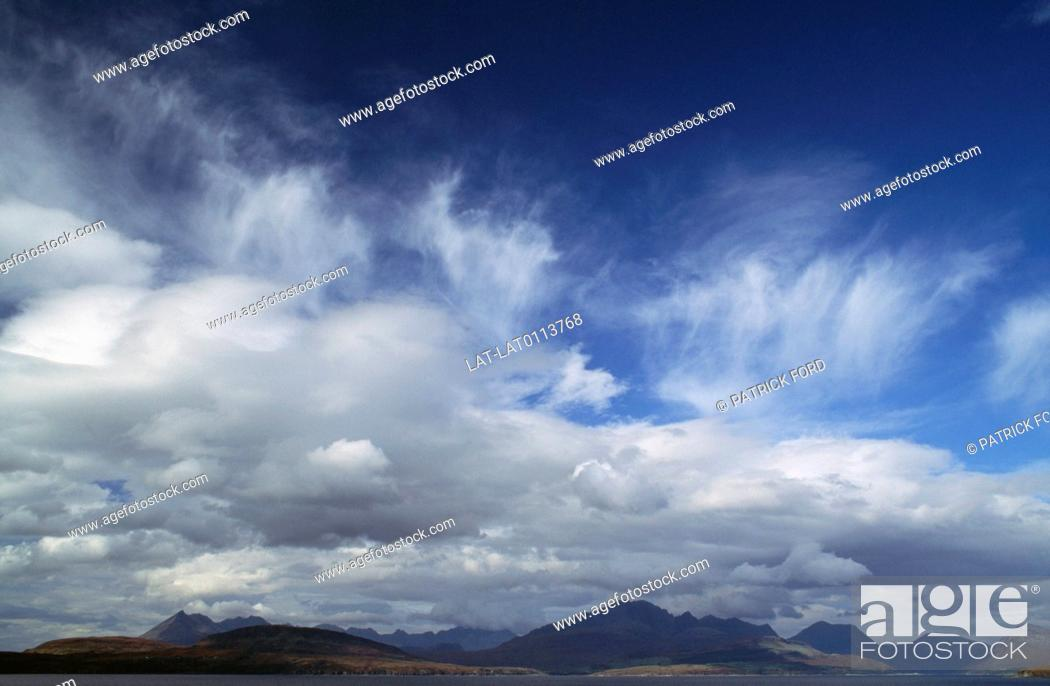 Stock Photo: Clouds are a visible mass of condensed droplets, frozen crystals suspended in the atmosphere above the surface of the Earth.