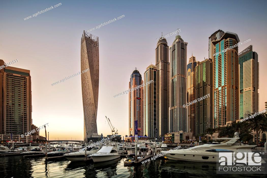 Stock Photo: Dubai Marina at sunset with the Cayan Tower (Infinity Tower), the Dubai Marriott Harbour Hotel and Suites and various residential towers, Dubai Marina, Dubai.