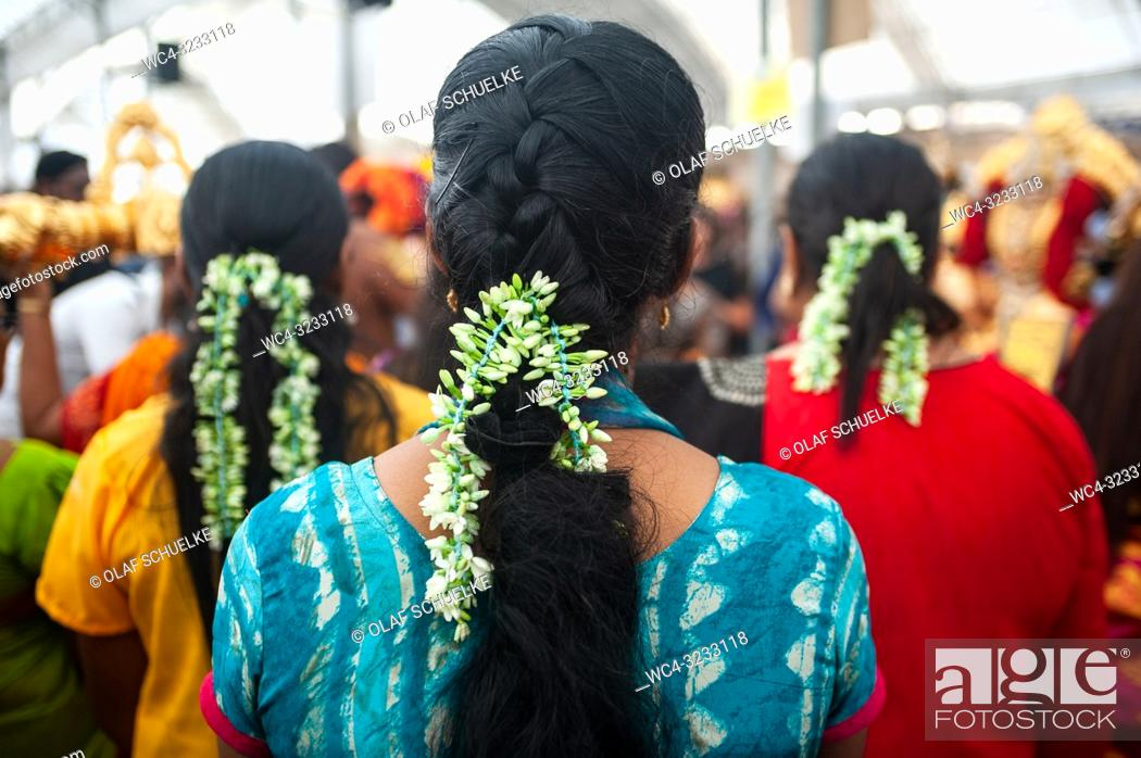 Stock Photo: Singapore, Republic of Singapore, Asia - Hindu women wearing traditional floral ribbons during the preparations for the Thaipusam festival at the Sri Srinivasa.