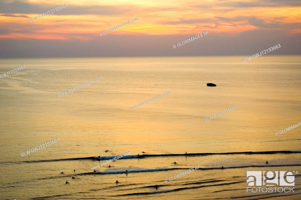 Stock Photo: High angle view of tourists swimming in the sea, Cote des Basques, Biarritz, France.