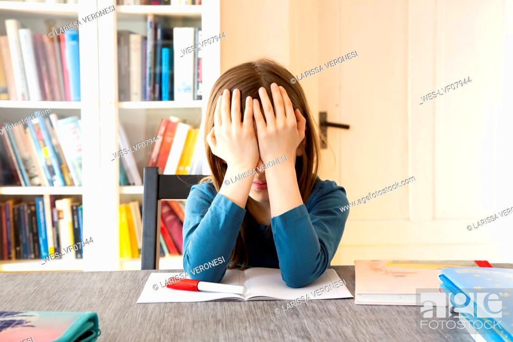 Stock Photo: Frustrated girl with homework.