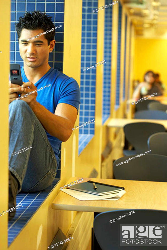 Stock Photo: College student using a mobile phone.