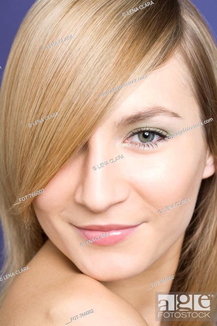 Stock Photo: Headshot of a young woman with blond hair.