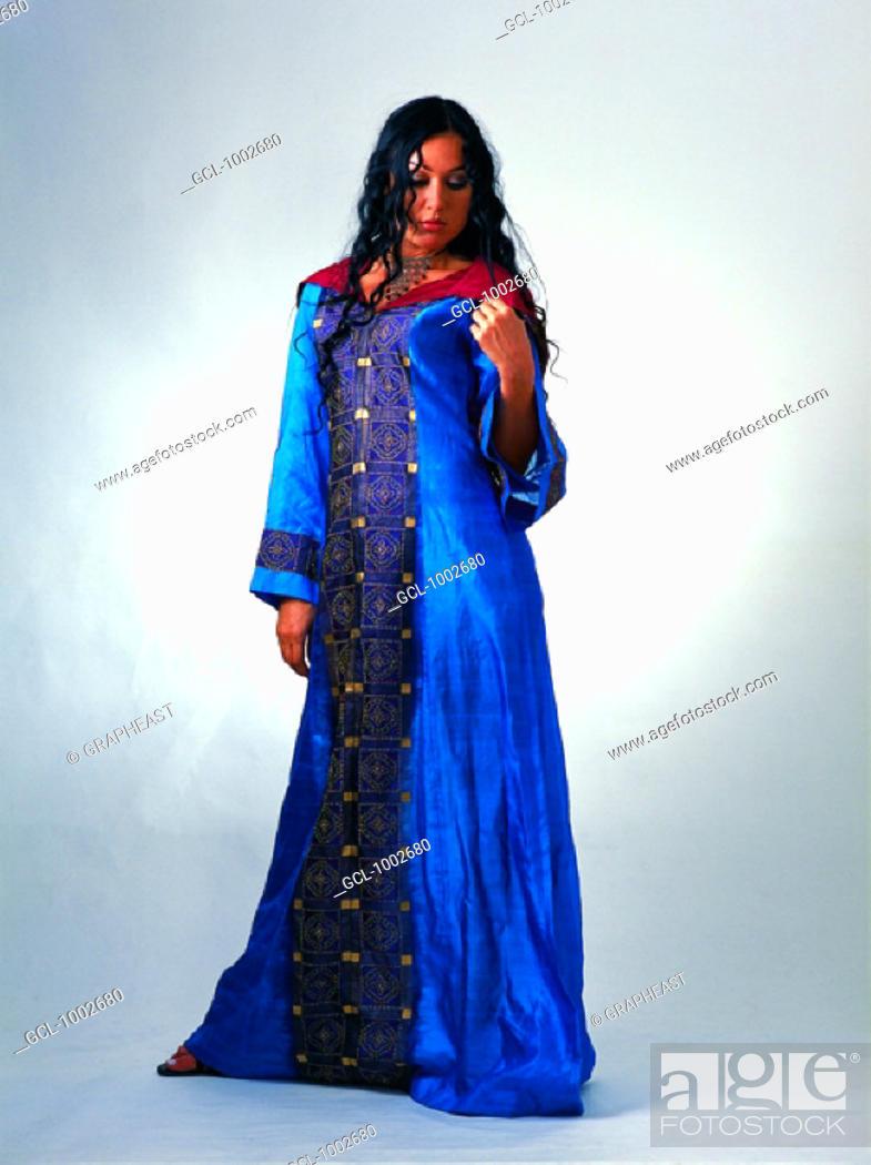 Stock Photo: Woman wearing a traditional Arabian dress.