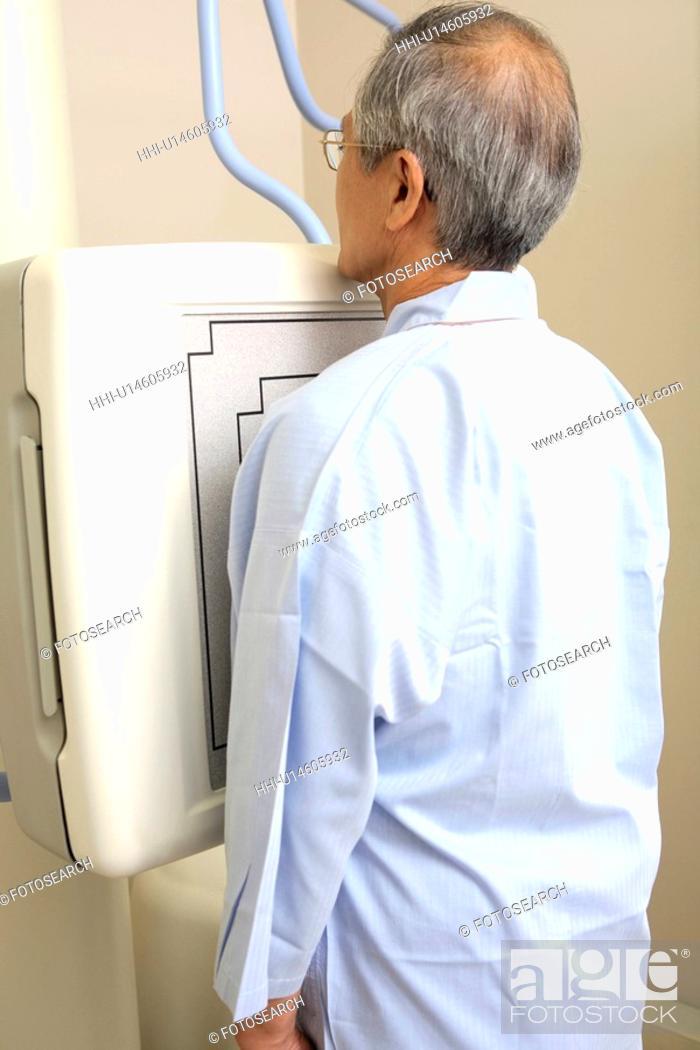 Stock Photo: Man examined by X-ray.