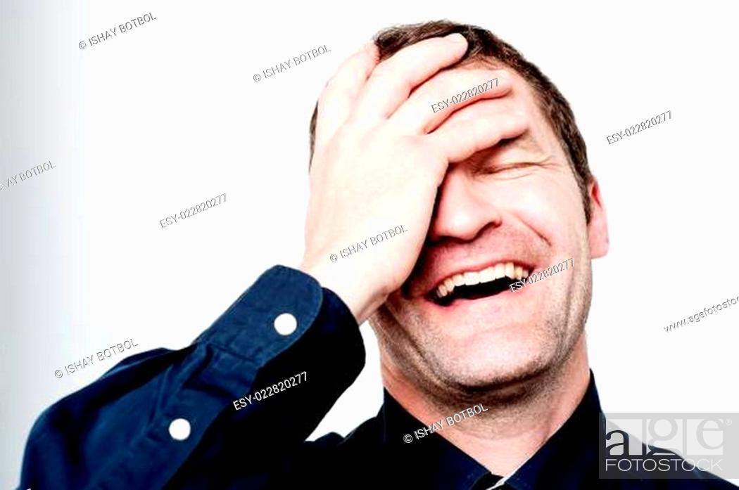 Stock Photo: Close up portrait of hard laughing man.