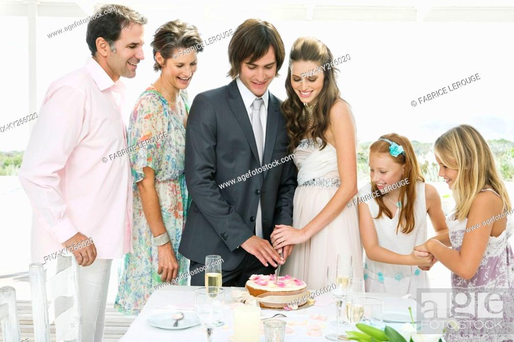 Stock Photo: Newlywed couple with guests in a wedding party.