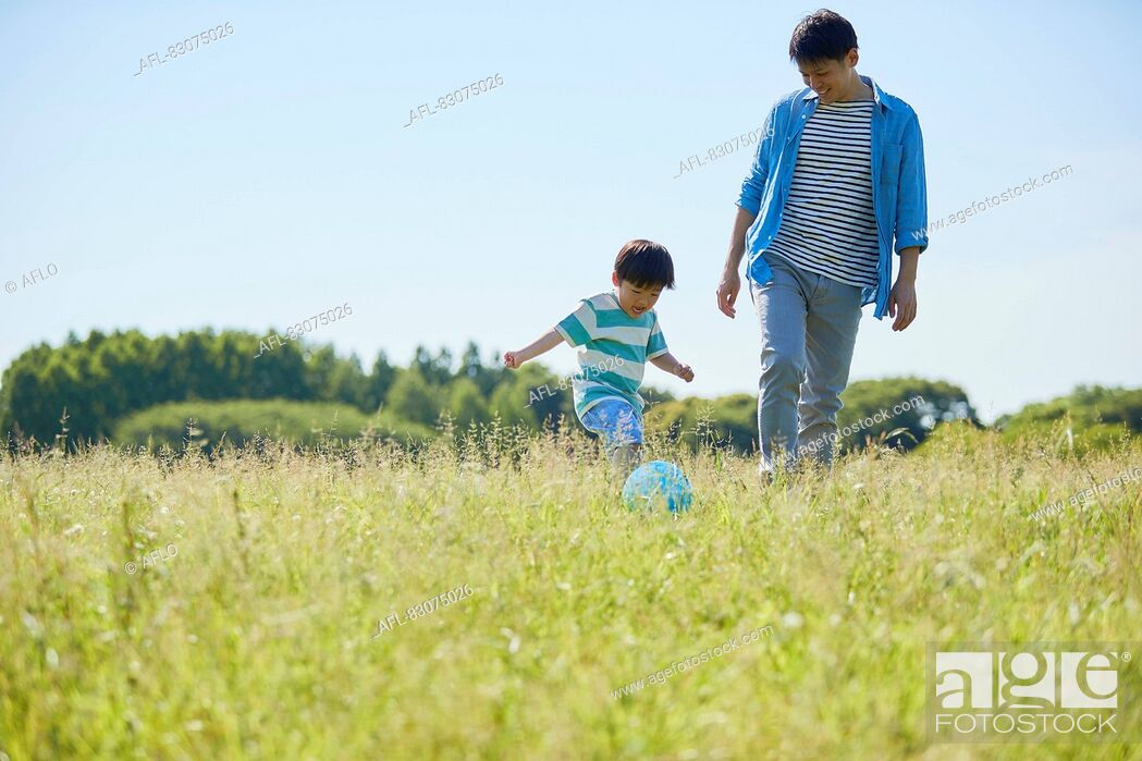 Stock Photo: Japanese father and son at the park.