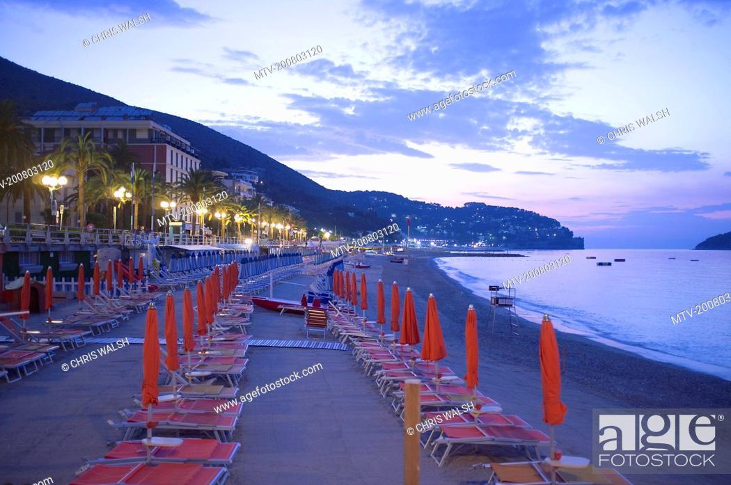 Stock Photo: Sunrise Italy beach sunshades hotels deckchairs.