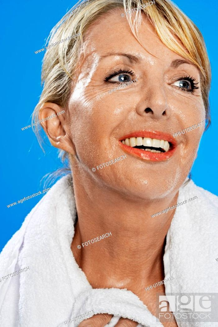 Stock Photo: Mature Woman with Towel Around Neck.