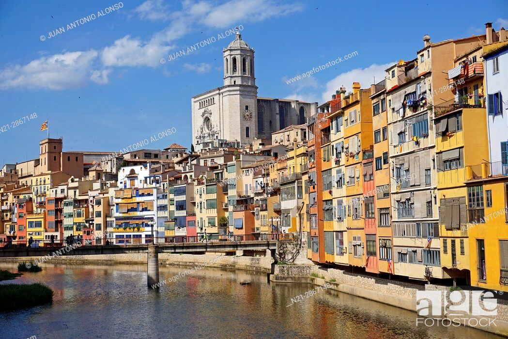 Stock Photo: Buildings on the Onyar River. In the background the tower of the cathedral stands out. City of Girona, Catalonia, Spain, Europe.