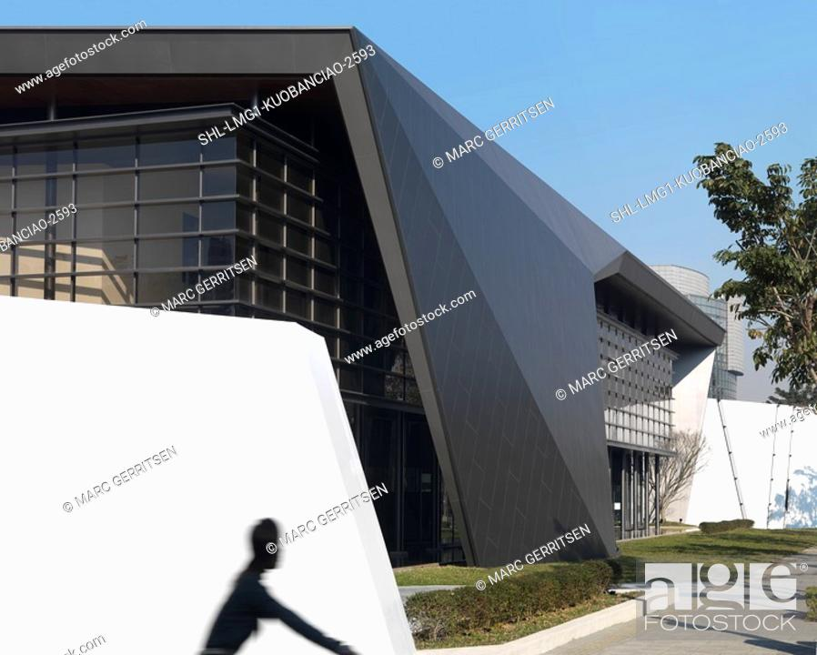 Stock Photo: Shadow of bike rider on white wall outside modern building.