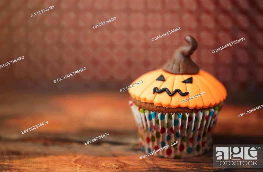 Stock Photo: Halloween design homemade cupcake on dark background.
