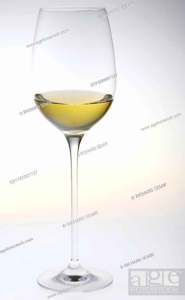 Stock Photo: wineglass with white wine.