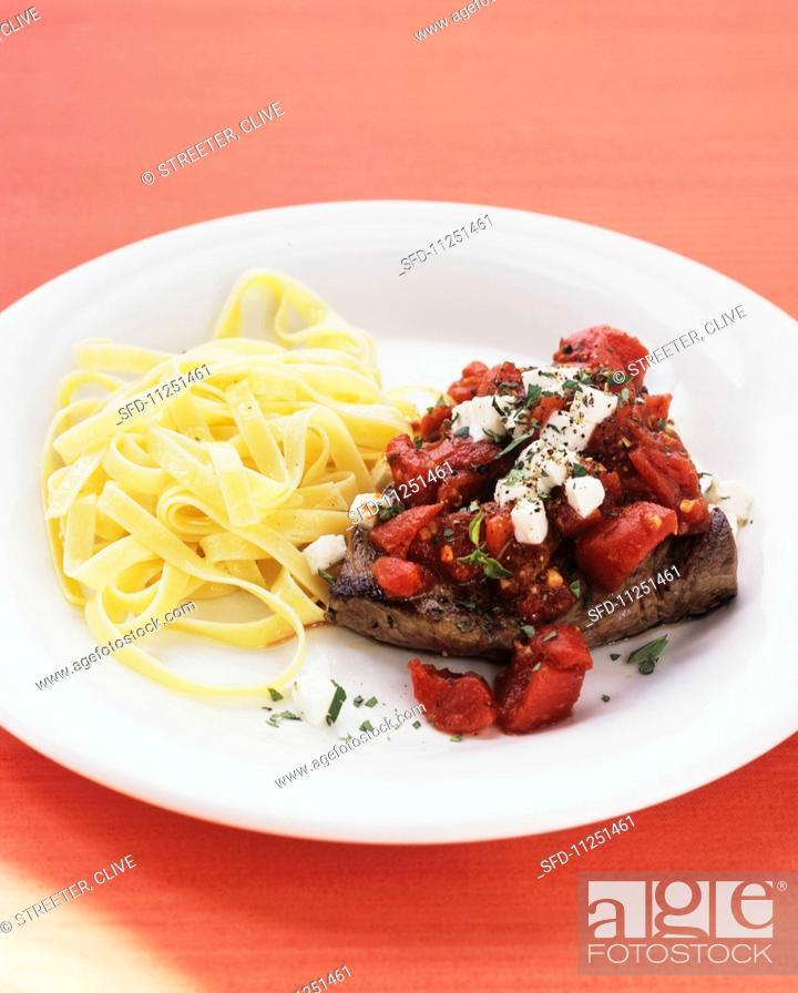 Photo de stock: Steak pizzaiola with tagliatelle.