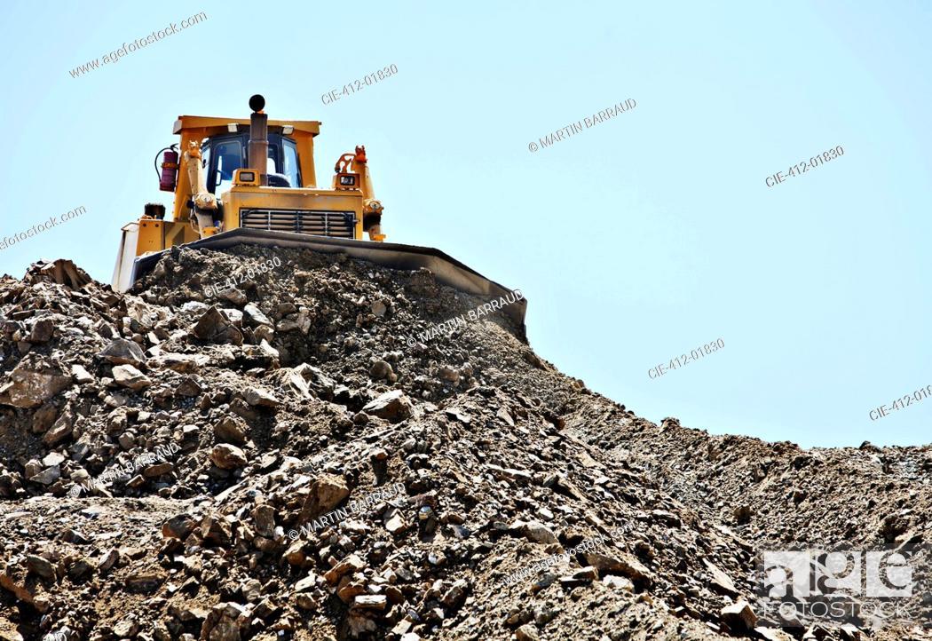 Stock Photo: Bulldozer working in quarry.