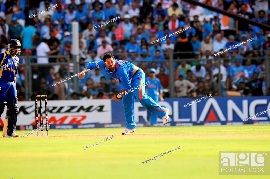 Stock Photo: Sri Lankan batsman Mahela Jayawardena looks on as Indian all rounder Yuvraj Singh bowls during the ICC Cricket World Cup finals against Sri Lanka played at the.