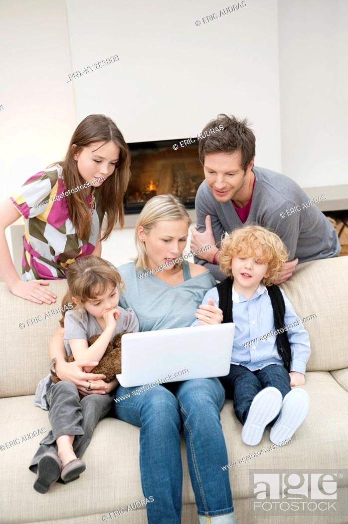 Stock Photo: Family using a laptop.