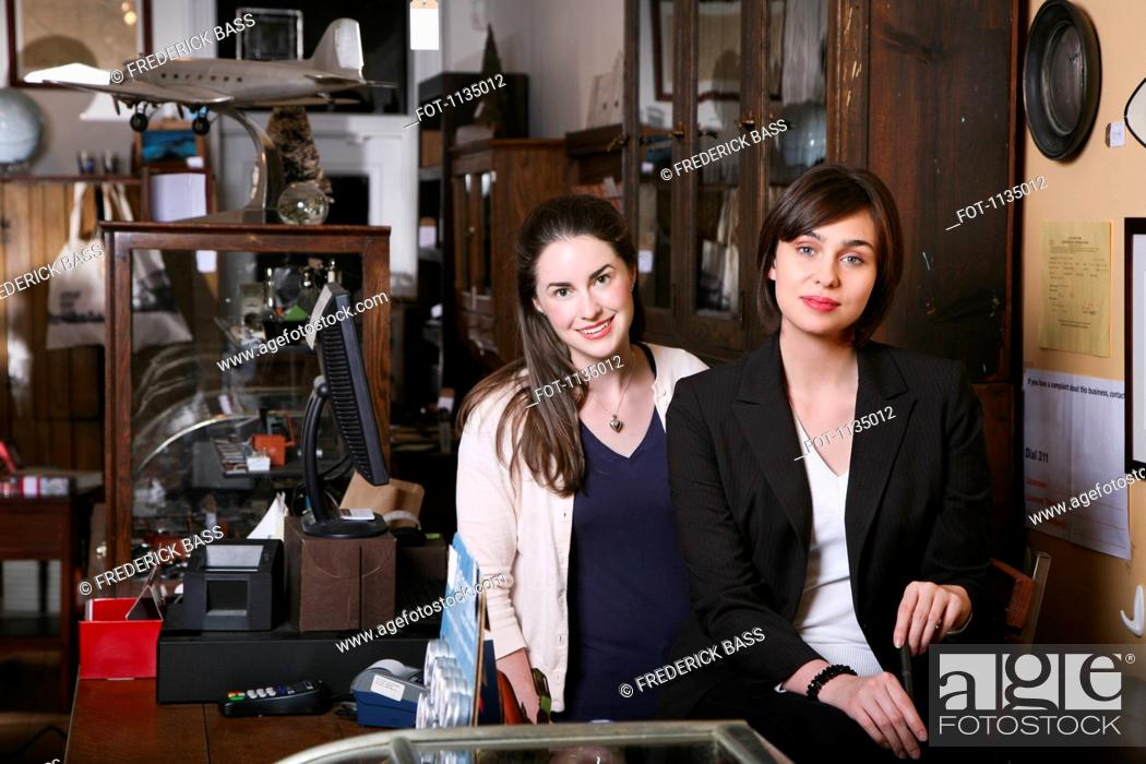 Stock Photo: Two woman in an antiques shop.