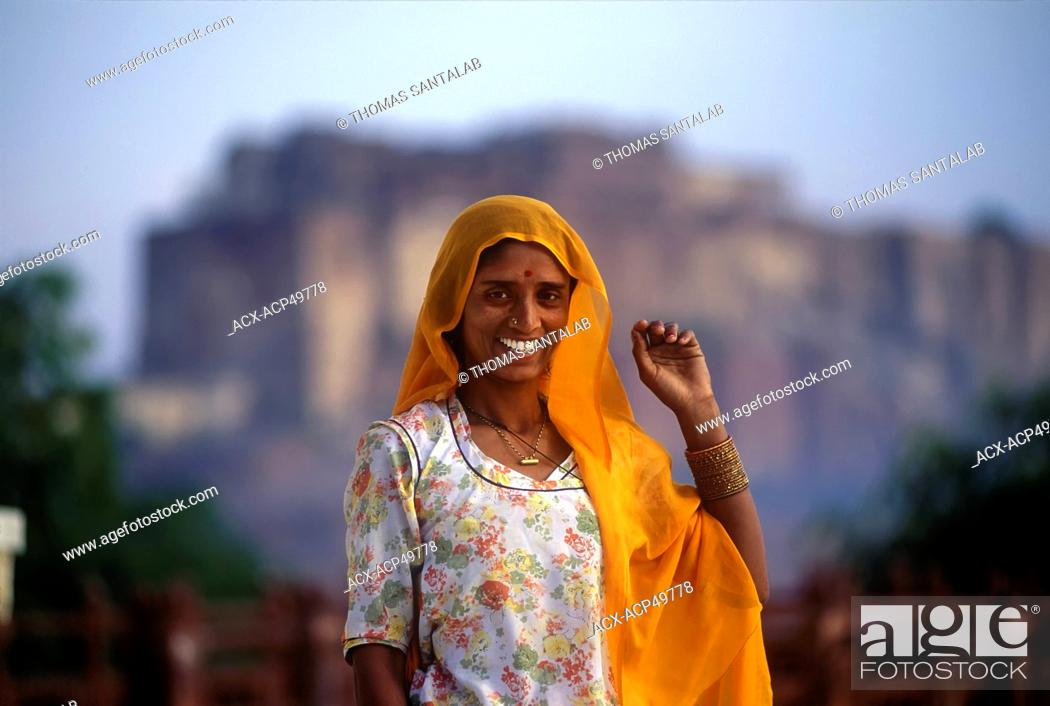 Stock Photo: A Rajasthani woman poses in front of Kumbhalgarh Fort in Udaipur, India.