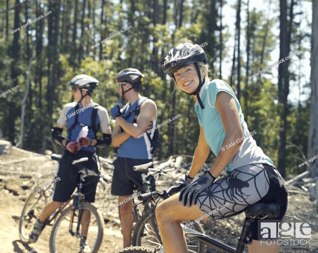Stock Photo: Three mountain bikers on a path.