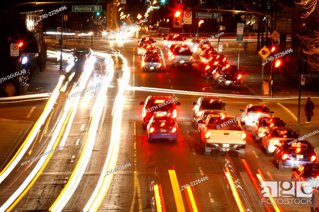 Stock Photo: Long exposure of traffic at night in downtown Vancouver, British Columbia.