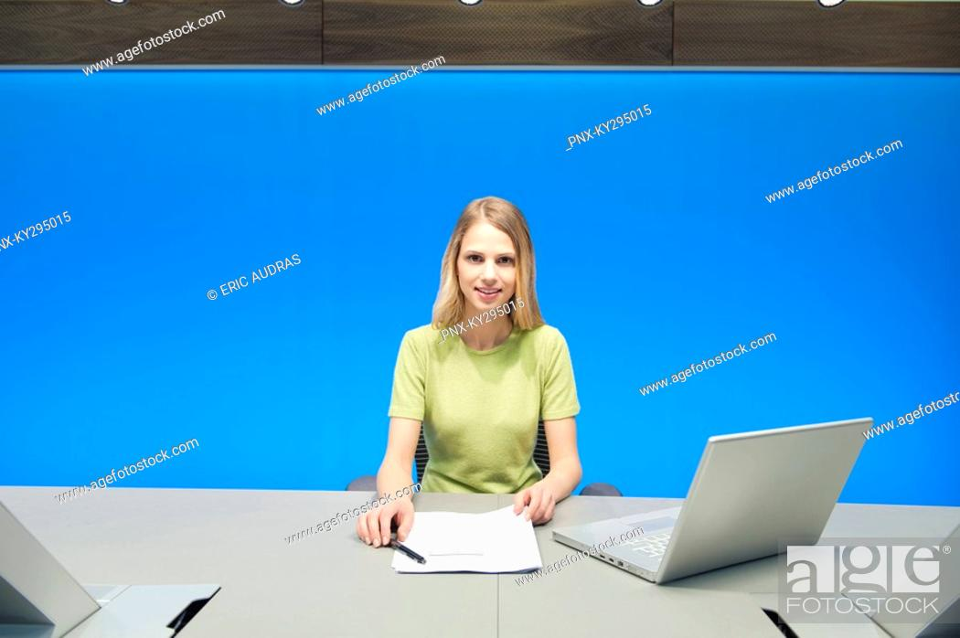 Stock Photo: Businesswoman working in a conference room.