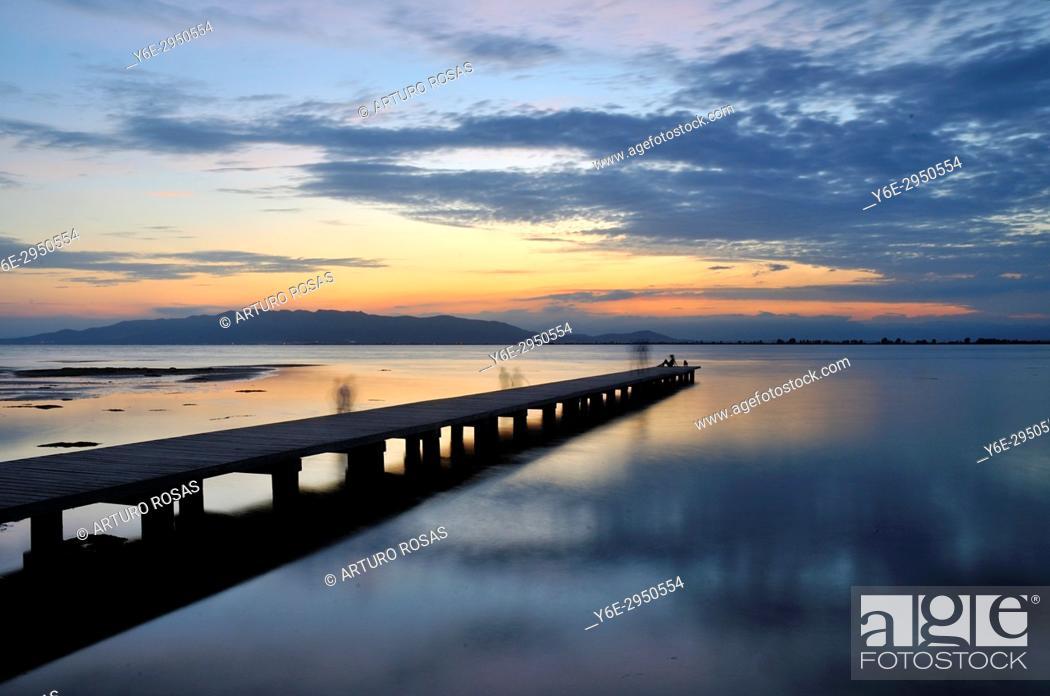 Stock Photo: Sunset at El Trabucador Beach in Ebro Delta, Tarragona. Catalonia, Spain.
