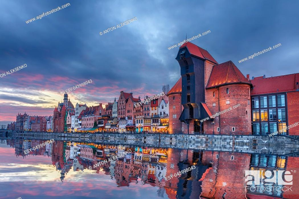 Stock Photo: Gdansk beautiful sunset, view on Zuraw port crane and medieval facades, Poland.
