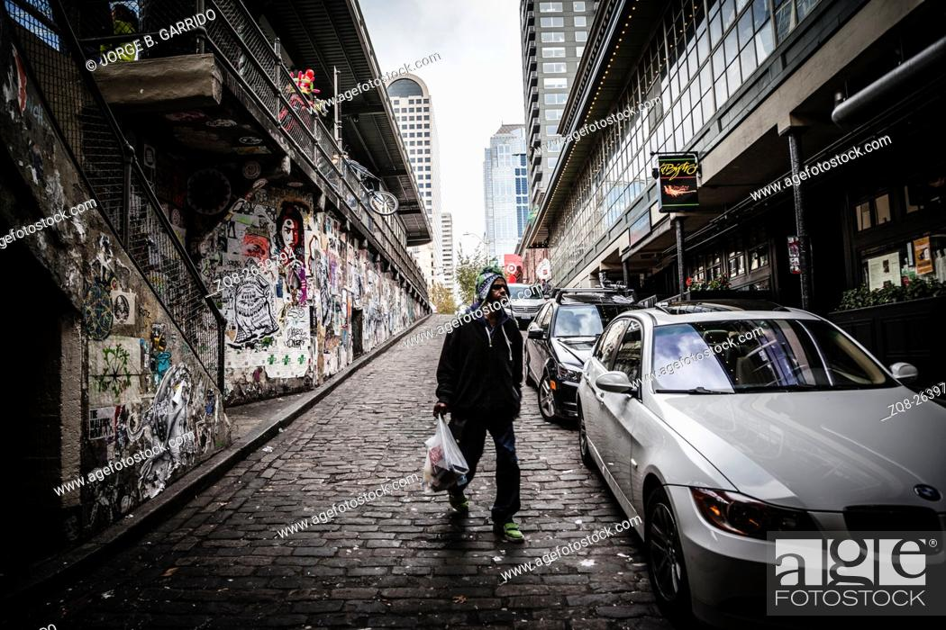 Stock Photo: Man walking to the Post Alley under Pike Place Market, Seattle, Washington state.