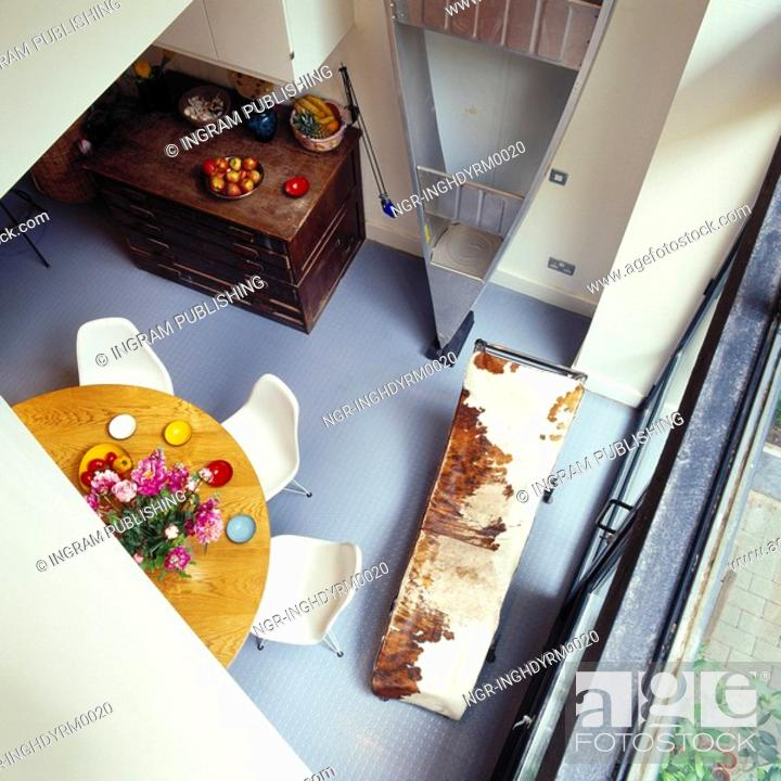 Stock Photo: High angle view of a dining table on a balcony.