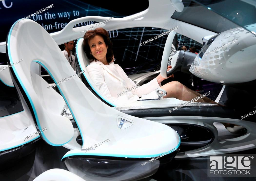 Stock Photo: Brand chairperson of Smart, Annette Winkler, sits in a Smart Fourjoy at the 'Mercedes-Benz & smart Media Night' on the evening before the start of the first.