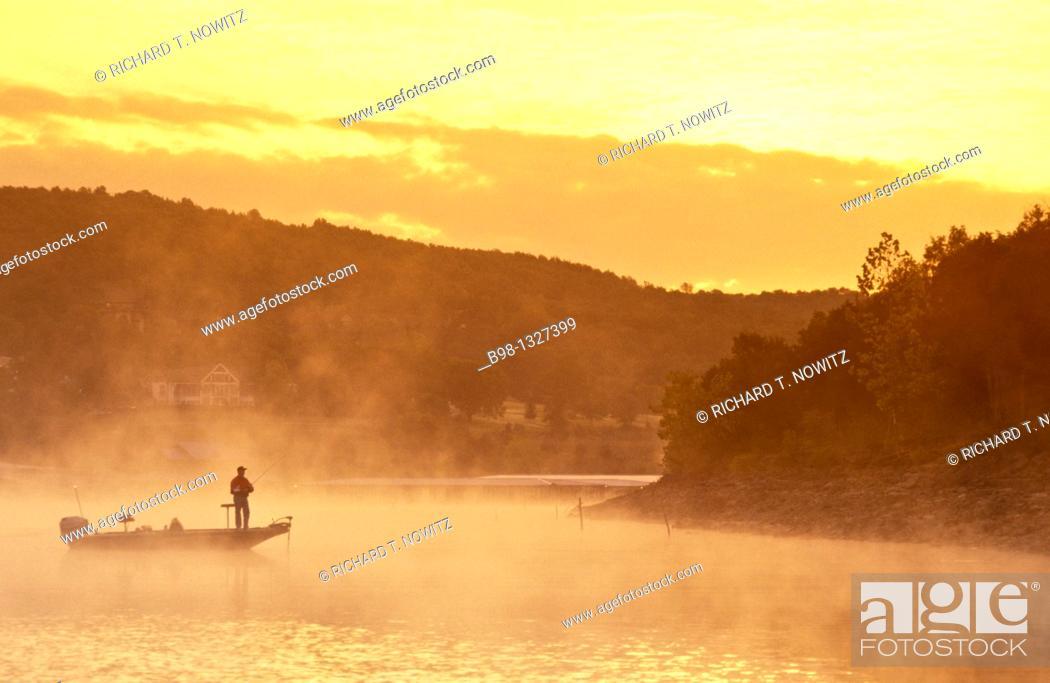 Stock Photo: Fishing at dawn in the Table Rock lake at Big Cedar Lodge, Missouri.