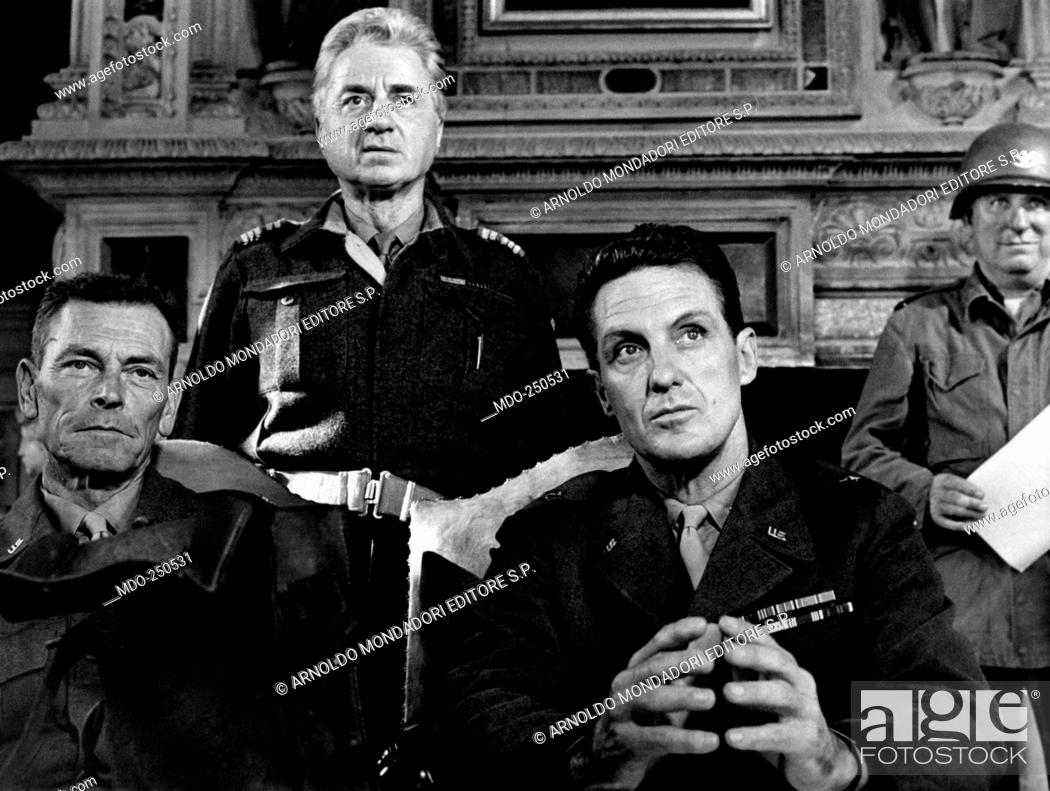 Robert Stack and Claude Dauphin seated in military uniform