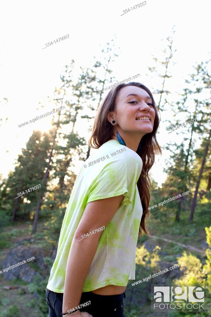 Stock Photo: A happy young caucasian woman outdoors.