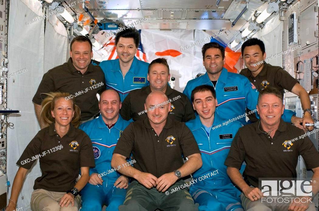 Stock Photo: The STS-124 and Expedition 17 crewmembers pose for a group portrait following a joint news conference from the newly installed Kibo Japanese Pressurized Module.